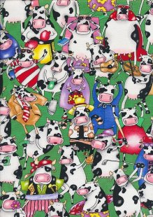Novelty Fabric - Sporting Cows On Green