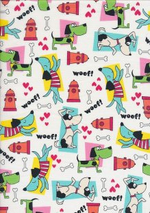 Novelty Fabric - Woofing Dogs & Bones On Ivory